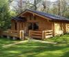 Красивый небольшой одноэтажный деревянный дом из лафета.